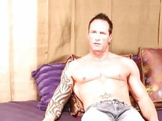 rock hard tattooed gay hunk jerks off his fat